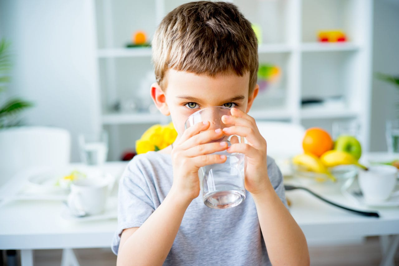 icosawater young boy drinking